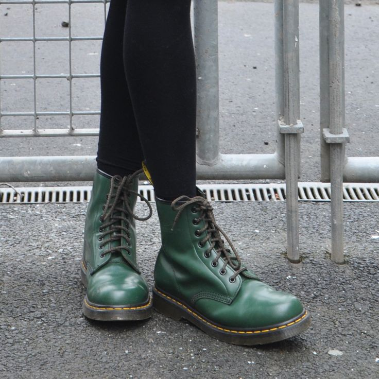 Classic Dr. Martens 1460 boot in green leather.