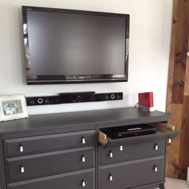 ikea dresser made entertainment center with the top drawers on hinges to hide the dvr and dvd. Black Bedroom Furniture Sets. Home Design Ideas