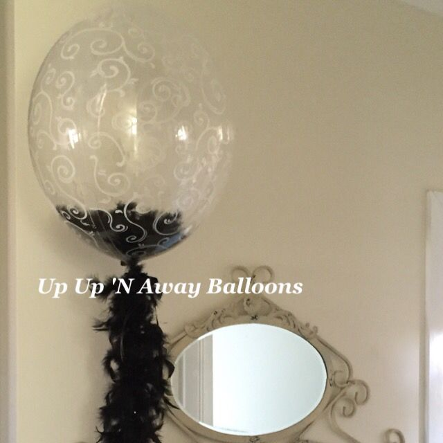 Deco Bubble with feather boa and feathers inside