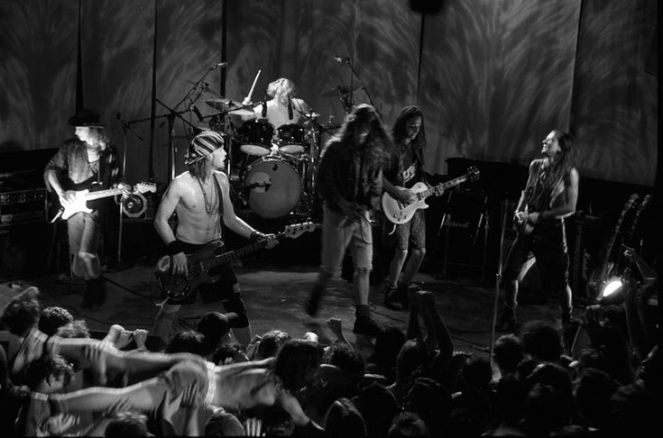 """At the end of this memorable show at RKCNDY on Aug. 3, 1991, Pearl Jam was joined by Soundgarden's Chris Cornell, center, and drummer Matt Cameron, for a short Temple of the Dog set. Earlier in the show, the song """"Alive"""" was filmed for a video. (Lance Mercer/1991)."""