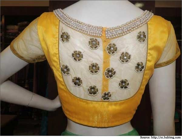 This bright yellow #designer net blouse is very rare that has beautiful flower embroidery done on the netted portion.