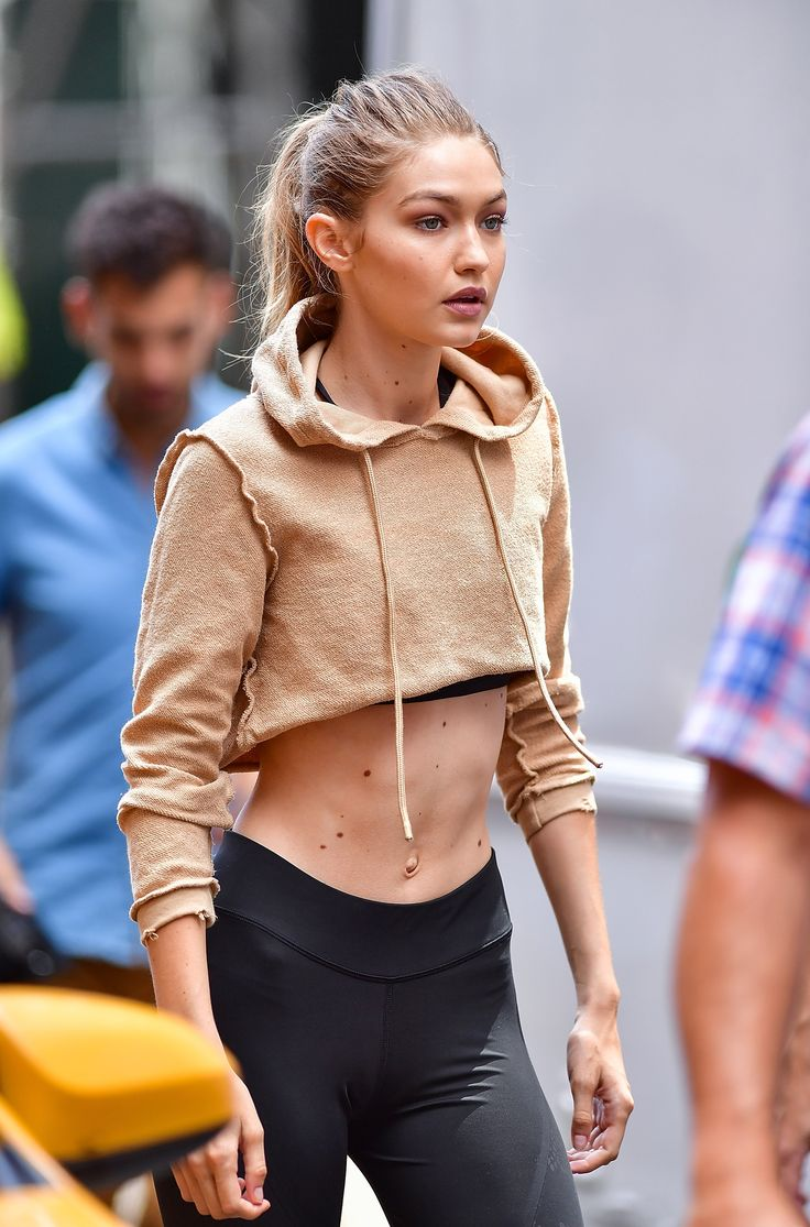 Gigi Hadid in New York, wearing a brown cropped hoodie.