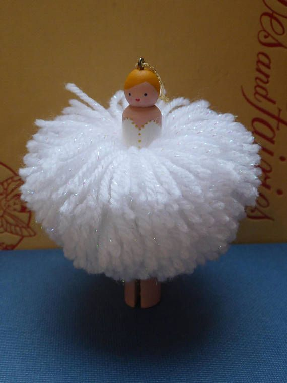 This delightful little fairy is designed to hang on a Christmas tree or wherever you like; she is also free standing...mine adorns my mantelpiece all year round. She is made from a wooden dolly peg which is painted in acrylic paint to resemble the penny dolls of old and her tutu