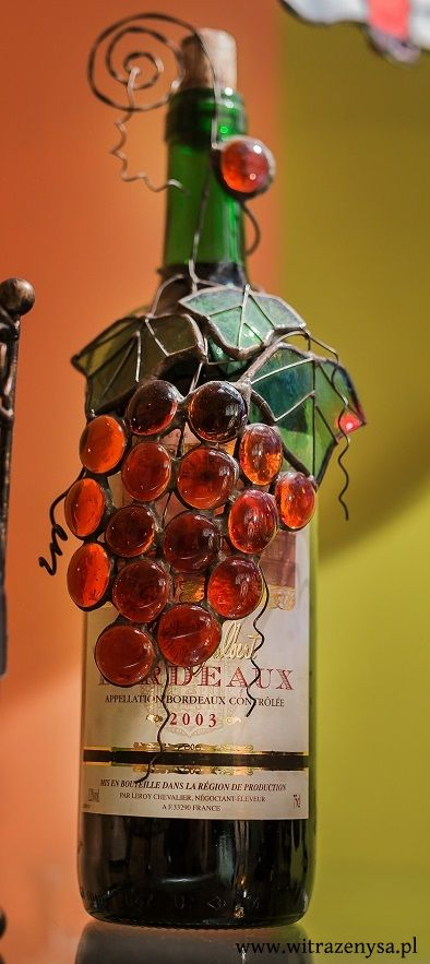 Stained glass, pendant on a bottle of vine