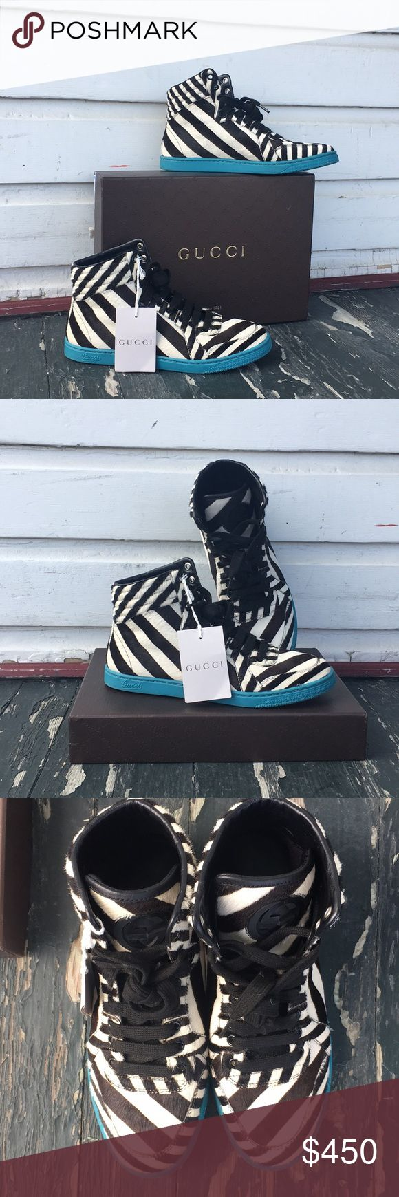 New! Gucci Zebra High Tops Gucci Zebra High Top Sneakers! Brand new with tags, box and original dustbag! Calf hair and leather. Gucci logo on tongue. Aqua base adds a unique splash of color! Padded lining and ankle. Round toe. Have some glue stains on toe as shown, came like that from the manufacturer! Size 37.5 fits a true US 6.5/7! Such a unique piece. I believe these are totally sold out! Unisex! Gucci Shoes Sneakers