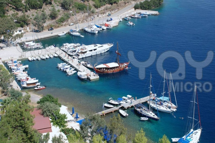 Boats moored in the harbour at Spilia Bay on the Greek island of Meganissi