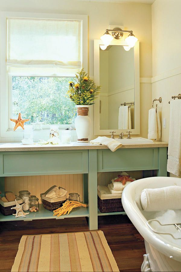 Accent with Color - 65 Calming Bathroom Retreats - Southernliving. Bring color into a neutral bath by painting your vanity in an accent hue.