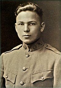 Sepia-color photo of a young man in military uniform. Frank Buckles.