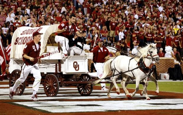 The Sooner Schooner makes a trip after a score during the second half of the college football game where the University of Oklahoma Sooners (OU) defeated the University of Kansas Jayhawks (KU) 52-7 at Gaylord Family-Oklahoma Memorial Stadium in Norman, Okla., on Saturday, Oct. 20, 2012. Photo by Steve Sisney, The Oklahoman