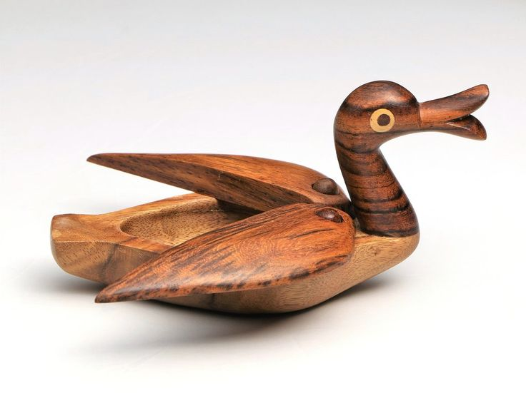 Wooden duck jewelry box: Fine-work Hand-carved artistic jewelry/stash box, decor and toy.  Size: Length: 12 cm app, Height: 7.5 cm app. Material: 100% from tropical Hard Tali wood (No rain forest was harmed). Method: Hand-turning, Hand-carving.