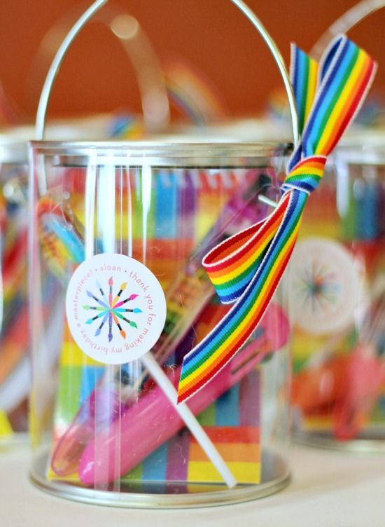 Must do: Favors Oriental Trading: rainbow notebook, stacking crayons, shuttle pens, rainbow lollipop
