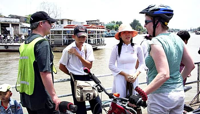 Cycling Mekong is great time to meet local school girl on local ferries - Vinh Long - Mekong - Vietnam