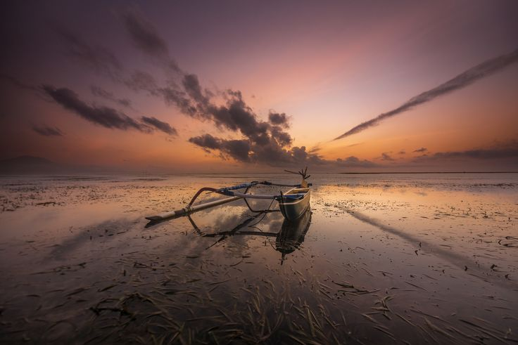 Surreal Bali - From Sanur beach in Bali, a outsdaning location to capture such a stunning sunrise with reflection, i was very lucky to have a dramatic clouds with such formation. so i decided to lock my shutter speed at 1 seconds since i want to document the moment as it is without any effect.