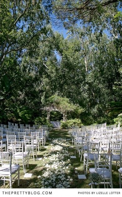 Outdoor aisle, white chair, baby's breath | Photography: Lizelle Lotter