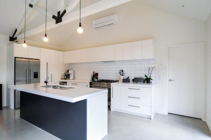 Arthur's Point House   All White Kitchen, Black and White Living, Clean Kitchen Design, Exposed Trusses, Black and White Trusses, White Polished Concrete Floor, Modern Industrial Kitchen   NZ Homes   Build me.   www.buildme.co.nz  