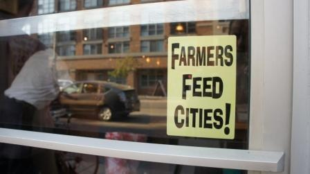 Rogerio Lira submitted this photo of a Farmers Feed Cities window decal in a shop window on King Street West in Toronto