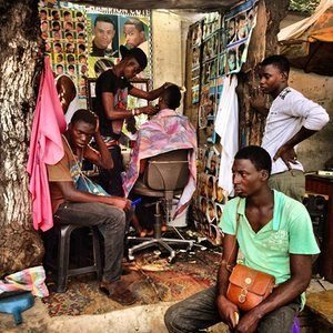 A barbershop on Tudu street in Ghana's capital Accra – where traders, hawkers and passersby drop in for a quick trim. Follow Nana on Instagram: @africashowboy