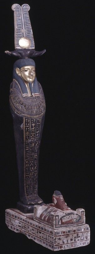Painted wooden Ptah-Sokar-Osiris figure; gilded face and disc; Hieroglyphic text naming Nesuy on plinth; compartment with vaulted lid topped with Sopedu-figure. Third Intermediate (?) 26th Dynasty (?)