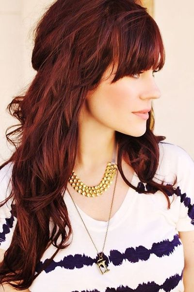 red hair with bangs - Eyebrow-grazing bangs make a great accent on long hair. Read more: http://www.dailymakeover.com/trends/hair/fall-haircuts-2014/#ixzz3E0hJROHo