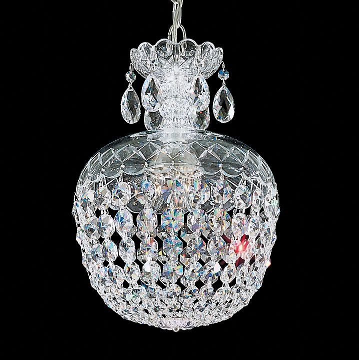 This signature classic by Schonbek is an all-crystal chandelier that pays homage to nineteenth-century Bohemia, where Schonbek was founded in 1870. This chandelier features hand-formed crystal columns, arms, and scrolls, and dense crystal ornamentation.