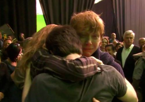 Shot of the 'Golden Trio' embracing after filming the last scene of Harry Potter and the Deathly Hallows Part 2, the final installment of the record breaking Harry Potter franchise [Rupert Grint (Ron Weasley), Emma Watson (Hermione Granger), Daniel Radcliff (Harry Potter)]