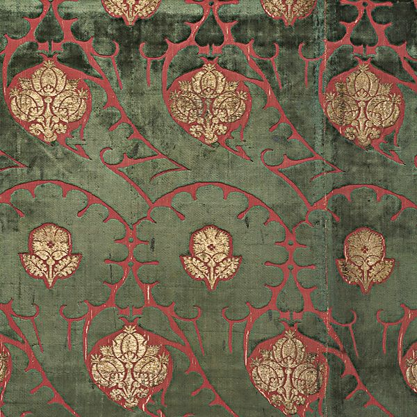 A late-15th-century panel of voided satin velvet, brocaded with gold, depicting carnations and pomegranates. © Victoria And Albert Museum, London