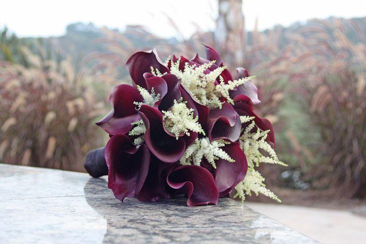 Bouquet of eggplant (schwartzwalder) calla lilies and white astilbe.