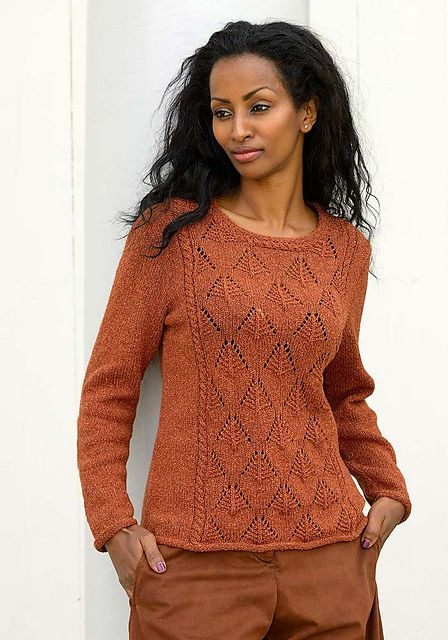 This sweater features a lace pattern framed with cables. The lace pattern is easy and straight forward to knit, the shape is classical, only accented by a cable around the neck.