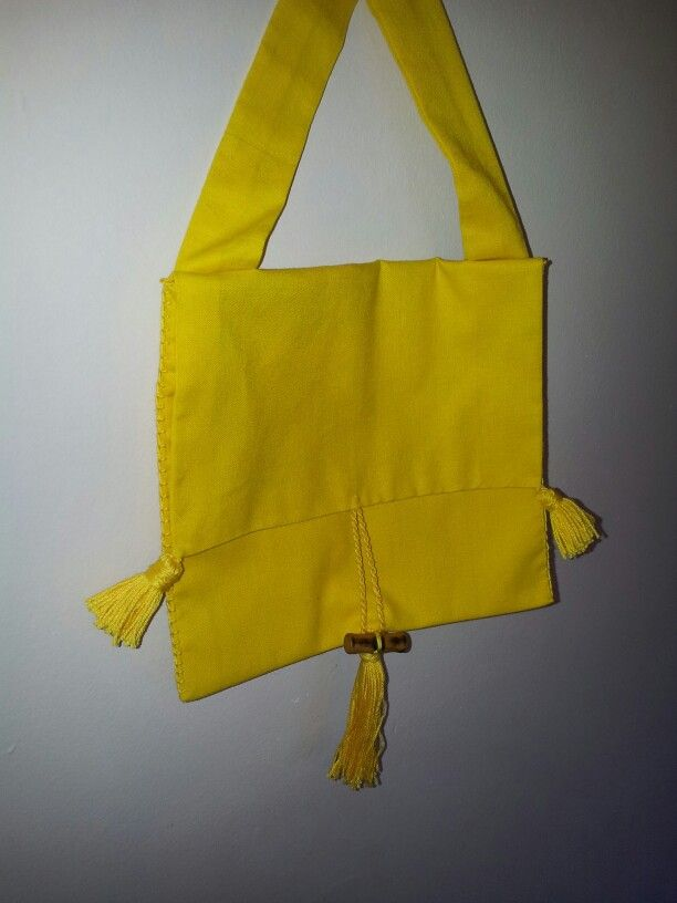 Yellow cotton homespun with fabric hanging strap, cotton tassels, wooden toggle closure. Made for Christmas 2013.