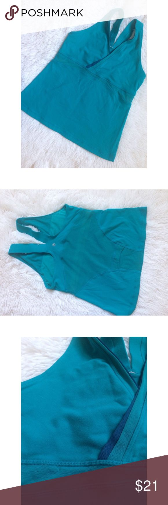 Lululemon Athletica Turquoise Deep V Wrap Mesh Top ☀️ SALE!! Lowest price, no offers please. 🍭Older style yet still classic lulu tank. GUC, sueding throughout but no stains, holes, tears. Top is similar to stock photo, included to show fit only. Colors are solid turquoise & blue mesh. ✖️NO TRADES • NO PP • NO MERC@RI  ✔️ADD'L INFO/PICS BY REQUEST ✔️POSTED = AVAILABLE lululemon athletica Tops Tank Tops