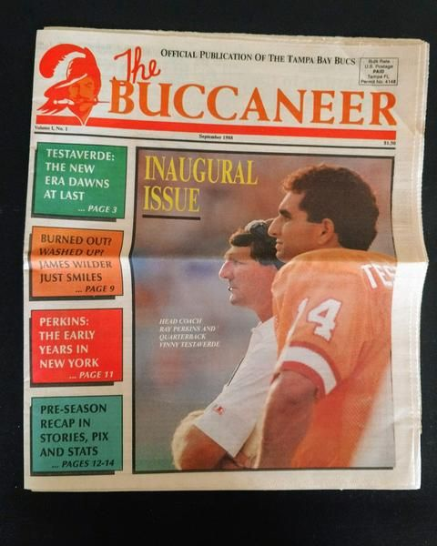 The Tampa Bay Buccaneer is the official newspaper for the Tampa Bay Bucs! This listing is for the very first printing of the inaugural issue (Volume 1, Number 1). In very good condition, there is no foxing or staining on the pages. There is a crease through the center due to folding. The main article of interest is on quarterback Vinny Testaverde. This is a great collectors item for any Buccaneer fan!