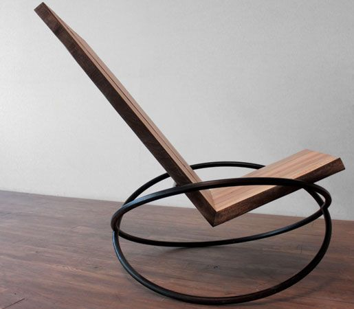 Andre Joyau's Bascule Chair is a rocking chair in reclaimed maple with a blackened-steel base.