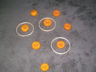 Another ring toss idea...using mini pumpkins instead if witch hats