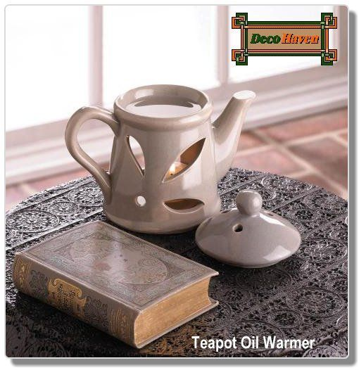 Teapot Oil Warmer - This little teapot hides an aromatic secret: it's not just a charming ceramic decoration! Lift the lid to uncover a basin that's ready for the scented oil of your choice, and behind the decorative cutouts is the perfect place to nestle a tealight candle. It will fill your room with scent and charm.
