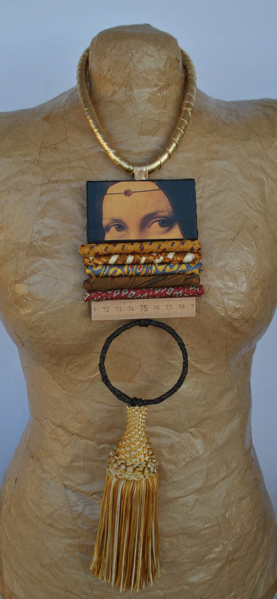 Hand-sewn necklace composed of pendant with Leonardo da Vinci pianting (Belle Ferronière), silk lined ropes, meter, fabric lined circle and tassel. Loop and button for fastening.  One of a kind piece.  Nice packaging included.  Choker length: 48 cm (18,90 inches) Rings pendant length: 37 cm (14,60 inches)   P.S.: To choose my necklace you should not be shy, because once you wear them all eyes roofs lean against.  Engage your friends in the order, this way you can divide your fees!  I can…