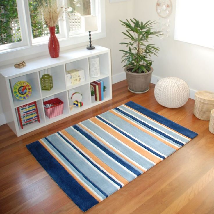 Lined Up Kids Rug in navy & rusty orange from BugRugs.  We love the colours in this children's rug!  The rusty orange accent of the rug is divine and an easy match to current decor for boys.  Perfect for nurseries, bedrooms and playrooms.  Available in 1.1m x 1.6m size.
