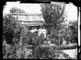 Holtermann Collection : photographs of goldfield towns in N.S.W. and Victoria; Sydney and Melbourne streets and buildings, 1871-1876.  Family in the garden of their bark roof house, Hill End.  .  Created by the American & Australasian Photographic Company, 1870-1875.  http://www.acmssearch.sl.nsw.gov.au/search/itemDetailPaged.cgi?itemID=62827 From the collection of the State Library of New South Wales www.sl.nsw.gov.au