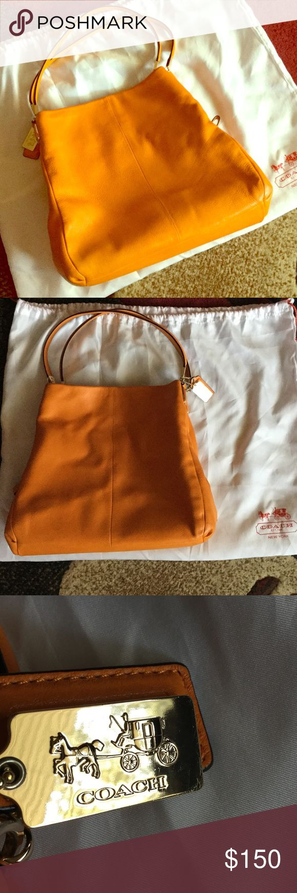 COACH hobo bag Great Fall color! Orange leather with dust bag. Used one season interior zip pocket and phone pouch additional space rom center zipper. Great bag for a busy, stylish Mom-on-the-go! Lots of compartments. Please comment with any questions. Coach Bags Hobos