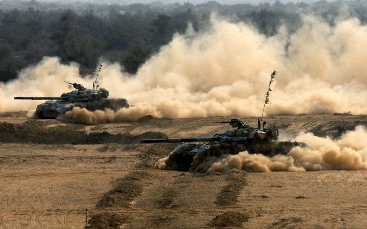 Khairpur Tamiwali, Pakistan, 04 Noember 2013: Pakistan Army tanks (Al Khalid) advance during a field exercise (named Azm -e- Nau IV) in Cholistan Desert of Southern Punjab, Pakistan.