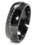 This dome profile Baseball wedding band is as stylish as they come. It features a nice lightweight comfort fitting black zirconium ring with the detailed stitches of a baseball carved into the ring. The carved stitch areas show off the natural silver color of the zirconium and really help this ring show off its true beauty. Available in only 7,8 or 9mm widths. Polished finish is only finish we are offering on this ring.
