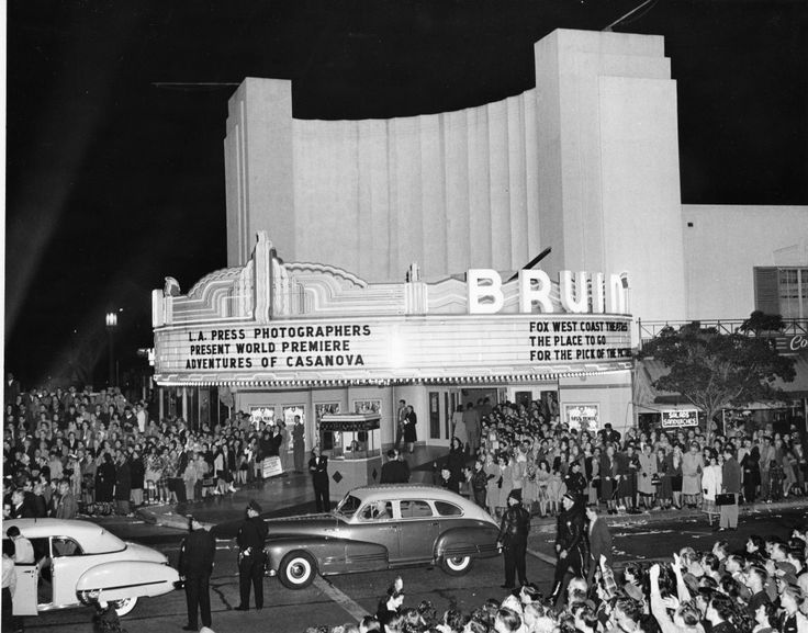 BRUIN THEATER PREMIERE, 1948. Glittering Hollywood film premieres have attracted throngs of movie fans to Westwood Village since the 1930s. The Bruin Theater opened across the street opposite the Fox Theater in 1937, as the second movie theater in the Village. This City Historic-Cultural Monument was designed by renowned theater architect S. Charles Lee in Streamline Moderne style, with UCLA inspired blue-and-gold neon flashing along the sweeping curve of its Art Deco style theater marquee.