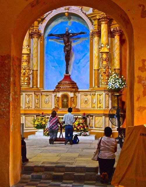 People praying in Cartagena de Indias, Colombia
