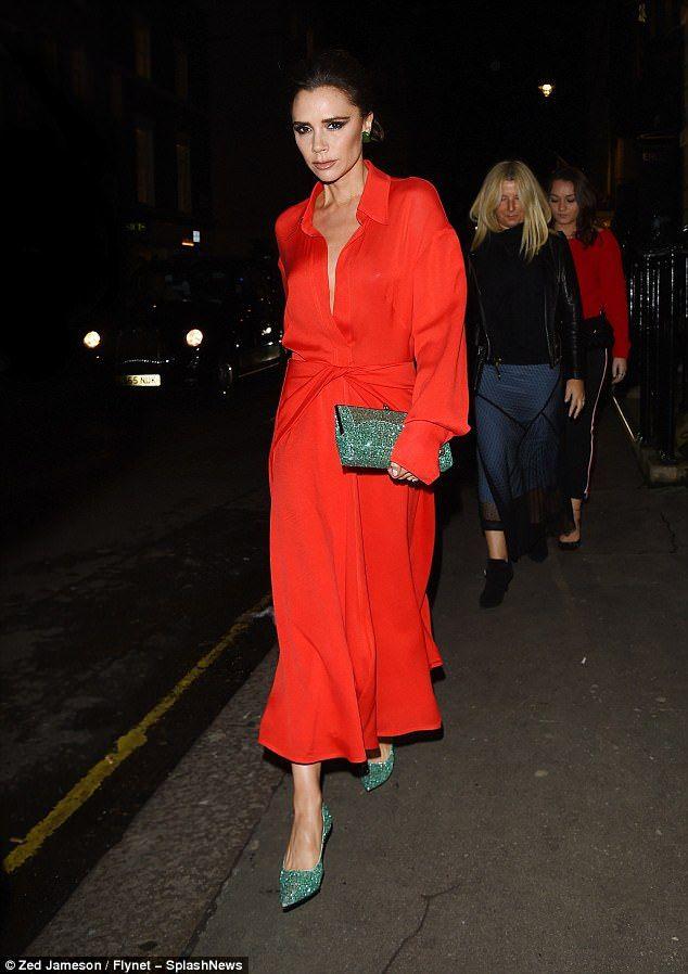 Victoria Beckham dons silky red dress and green glittering stilettos ... 7d13b933059