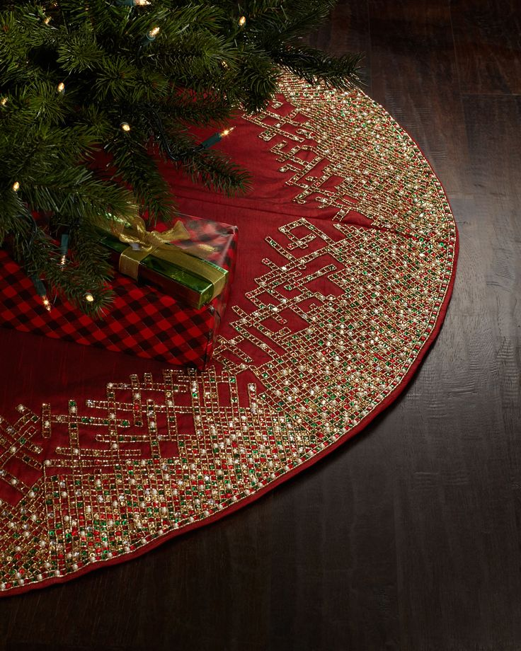 """Handcrafted Christmas tree skirt. Plastic and glass beads on polyester fabric. 64""""Dia. Spot clean. Imported."""