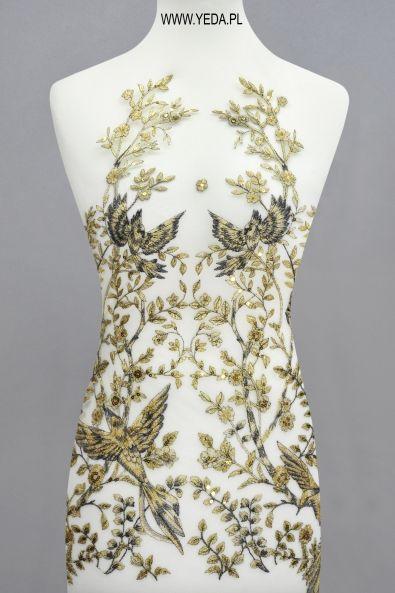 Koronka ML14409 TAŚMA ZŁOTA Doskonała na suknie koktajlowe lub wieczorowe. Idealna dla druhen, świetnie prezentuje się na przyjęciach weselnych,studniówkach lub balach sylwestrowych.