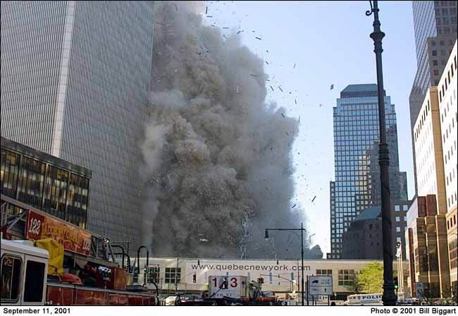South Tower crashes down over the Marriott Hotel. I was in the hotel near the lobby when this was happening. I was also the chauffeur of L-122 ( foreground ) that day. Lucky enough to survive the collapse this picture has special meaning to me.