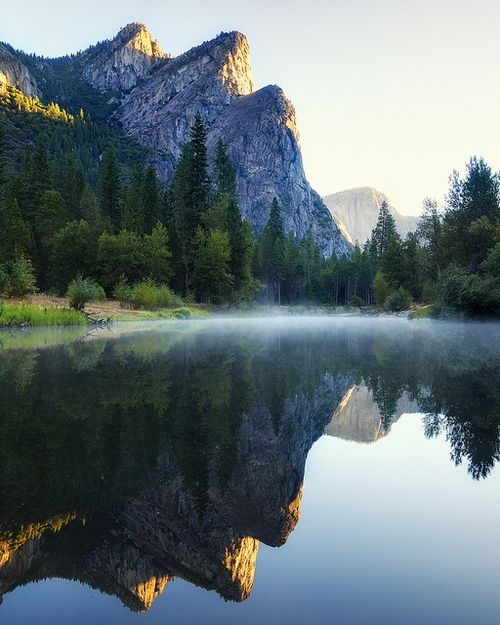First light on Three Brothers, Yosemite National Park, California, USA (by andrew c mace).