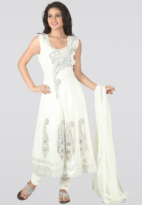 White coloured suit set for women from Sareez. Made from net, it comprises salwar, kameez and dupatta. Add glamour to your persona by adorning this exceptionally designed suit set from the house of Sareez. The beautiful keri work on the anarkali kameez makes this creation apt for special occasions.