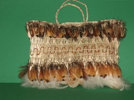 Matariki Gallery Maori Art, Giftware, Bone Jade and Wood Carvings from New Zealand.Kete Muka - Created by Rita Baker Made of 98% Harakeke (New Zealand flax),made of the Flax fibre, the other 2% are feathers, a real piece of art in traditional Maori style.