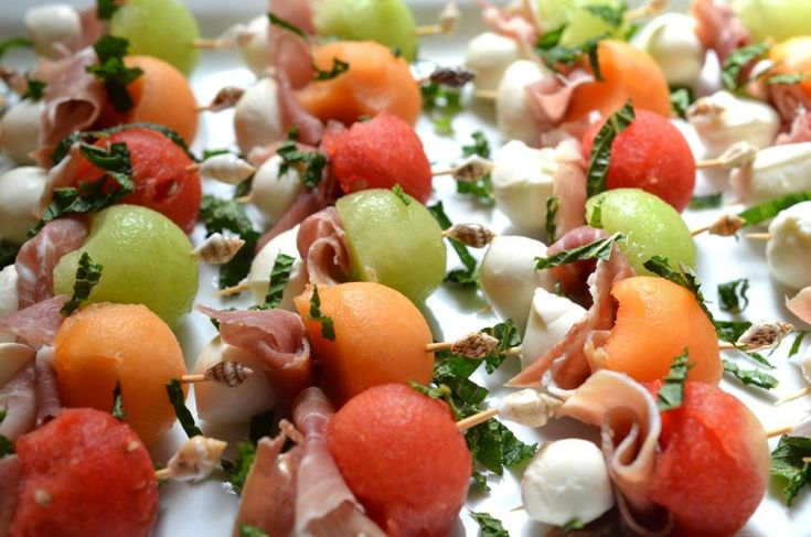 [ Melon-Mozzarella Skewers Recipe ] Adorable little skewers make a delightful appy for any party. #appetizer
